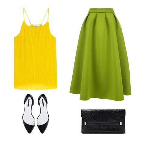 Зелена юбка-миди будет эффектно выглядеть в комплекте с желтым кроп-топом, черными балетками с острым носом и черным клатчем.