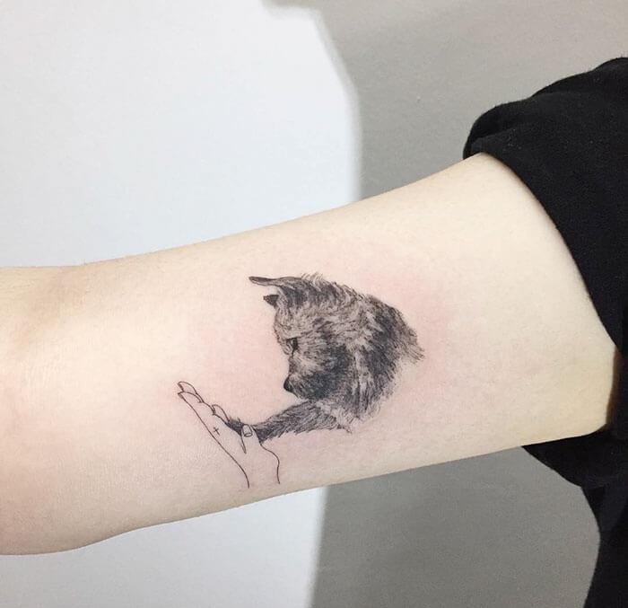 татуировка с собачкой