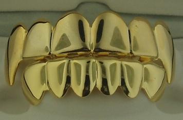 Звездный тренд: золотые зубы - фото №2