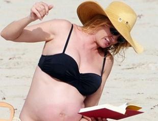 Беременная Ума Турман показала животик. Фото