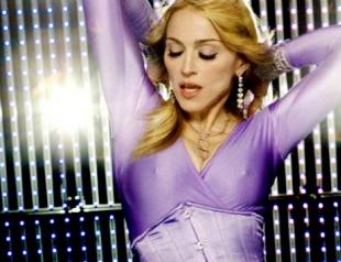 Тело, как у Мадонны: комплекс упражнений с полотенцем