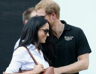 Принц Гарри и Меган Маркл не стесняются своих чувств: поцелуи и объятия пары на глазах изумленной публики